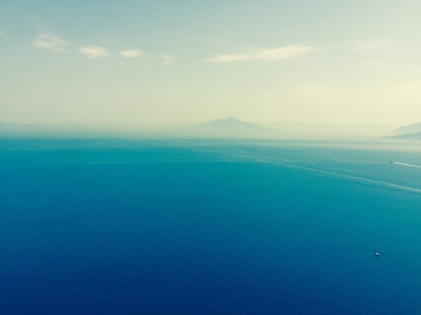 Afar you can see the island of Ischia